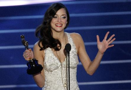 "Actress Marion Cotillard accepts the Oscar for best actress for ""La Vie en Rose"" during the 80th annual Academy Awards in Hollywood"